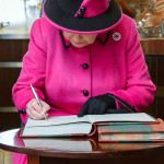 THe Queen signing the brewing journal